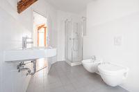 modern bathroom - white tiled bath with shower