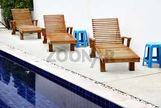 Chaise longues near pool