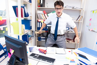 Busy frustrated businessman angry in the office