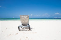 Lonely sunbed on Caribbean Beach