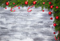 Christmas fir tree on wooden background