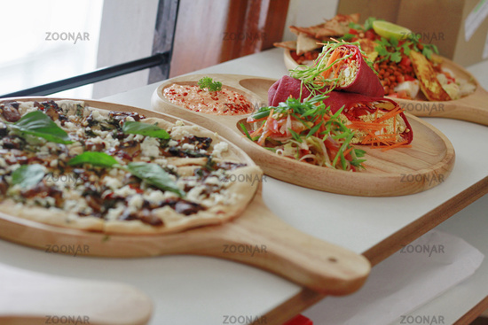 Array of colorful delicious pizza, tofu wrap and salads