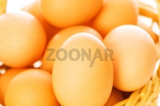 Many brown eggs in the basket - shallow DOF