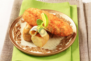 Fried fish fillet with new potatoes