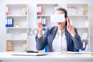 Businesswoman with virtual reality glasses in office