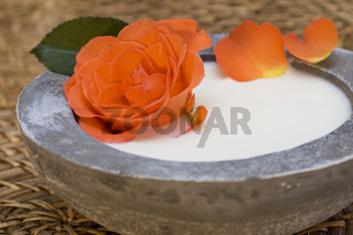 Wellness care products with roses petals