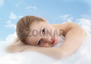 beautiful girl is resting in the clouds