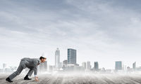 King businessman in elegant suit running and modern cityscape at background