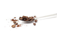 Spoon with coffee beans isolated on white