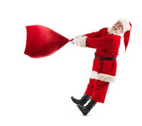 Santa Claus with bag with gifts