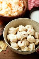 Dumplings stuffed with meat, pelmeni, ravioli, dumplings.
