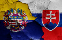 flags of Kosice and Slovakia painted on cracked wall