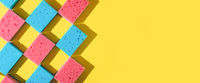 House cleaning sponges on yellow background