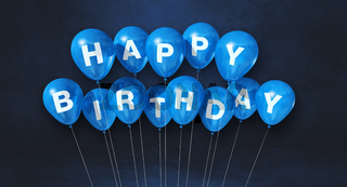 Blue happy birthday air balloons on a black background scene. Horizontal Banner