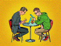 two men in a cafe are working on a laptop and a smartphone. Freelance in a restaurant