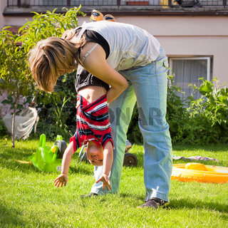 Woman and child boy having fun outdoors