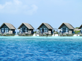 Water bungalows with steps beside sea