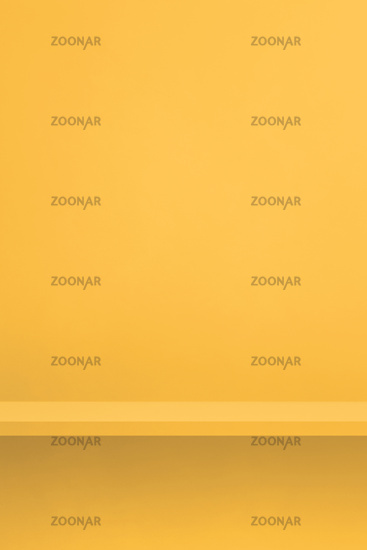 Empty shelf on a yellow wall. Background template. Vertical backdrop