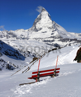 Red chair and Matterhorn, logo of Toblerone chocolate, located in Switzerland