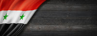 Syrian flag on black wood wall banner