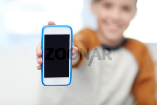 close up of boy with smartphone at home