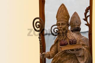 Wooden sculpture of a priest