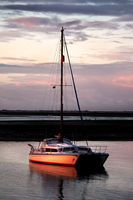Anchored boat at sunset