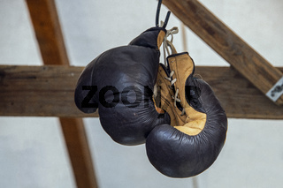 A used pair of boxing-gloves