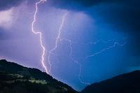 lightning bolts illuminate the sky