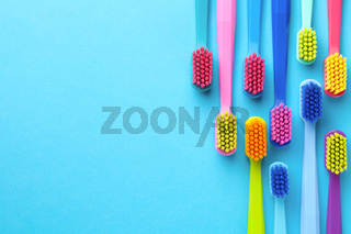 New Toothbrushes Over Blue Background