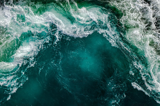 Waves of water of the river and the sea meet each