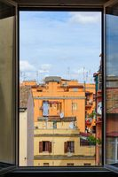 Typical view out of window to usual old residential buildings with tile rooftops in Rome, Italy