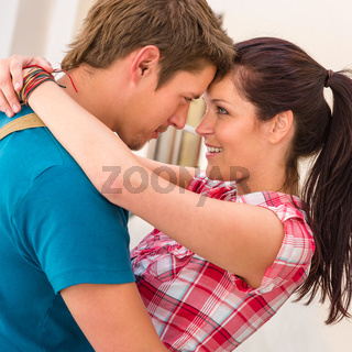 Young loving couple embracing and smiling romance