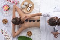 Woman at spa stone massage
