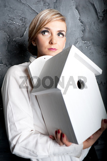 Attractive Businesswoman Holding Model Home