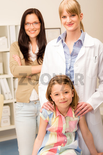 Little girl at pediatrician office with mother