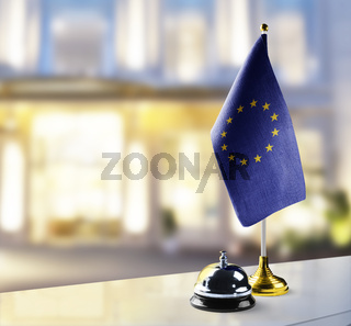European Union flag on the reception desk in the lobby of the hotel