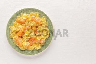 Smoked salmon with bowtie pasta. Farfalle with salmon
