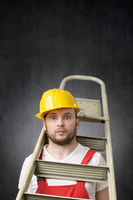 Portrait of a clumsy worker with ladder