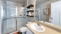 Pano Interior of a full bathroom with shelves and cabinet