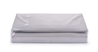 Grey cotton bedding sheets in clear plastic bag