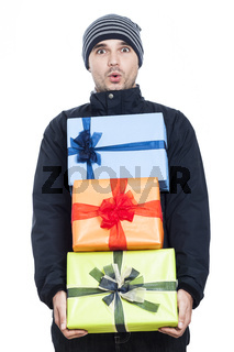 Shocked winter man with presents