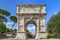 The iconic Arch of Titus on the Via Sacra in the Roman Forum in Rome, Italy
