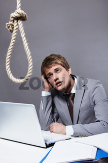 A young businessman looking at a loop in the workplace