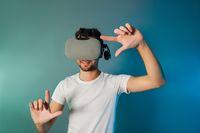 Man using virtual reality glasses for virtual shopping