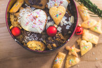 Homemade Christmas cookies: Delicious cookies, powdered sugar and Christmas bauble on rustic wooden table