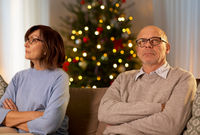 unhappy senior couple at home on christmas