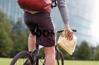 Bicycle messenger in Berlin delivering an envelope