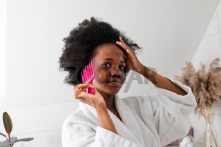 Charming smiling afro-american girl with messy hair