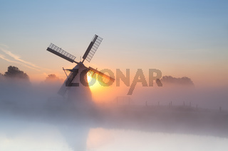 Dutch windmill in dense fog